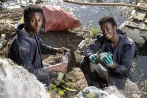 Adissu and Fasil, collecting plastic bottles on Hawassa lake